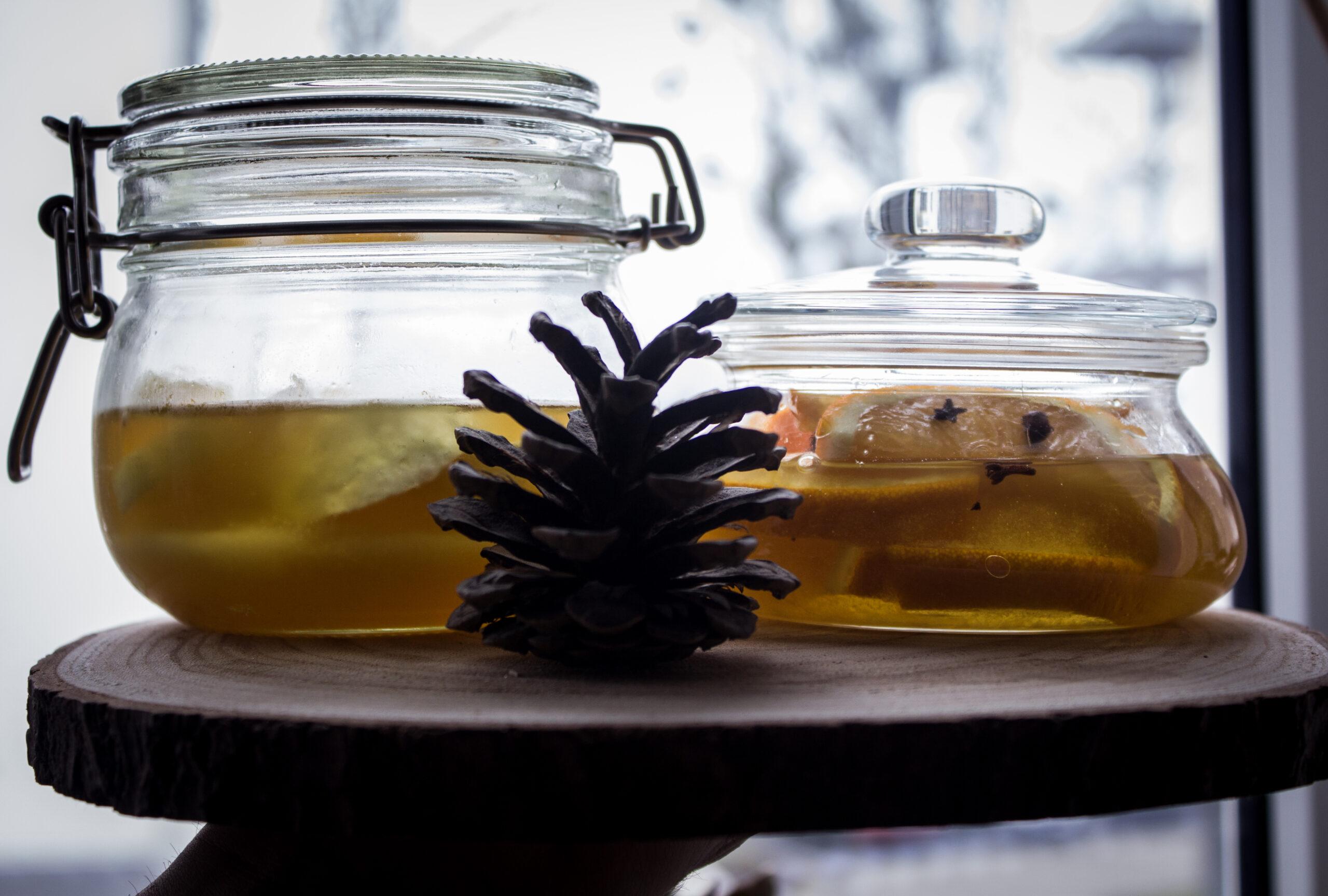 Cytryny i pomarańcze w miodzie, czyli idealny dodatek do zimowej herbaty.